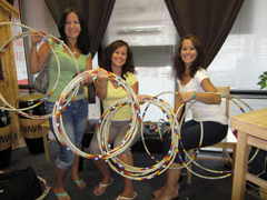 Family of Wholistix doing last minute repairs for Tony Redhouse Eagle Hoop Dance 2011